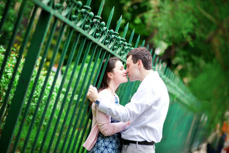 Beautiful kissing couple in Paris on the street Stock Photo - 14655398