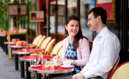 cafe table: Happy couple in a Parisian outdoor cafe