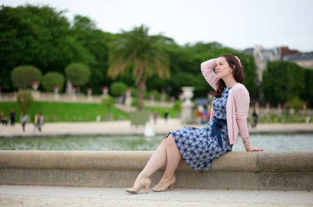 jardin de luxembourg: Beautiful young girl in Luxembourg garden of Paris Stock Photo