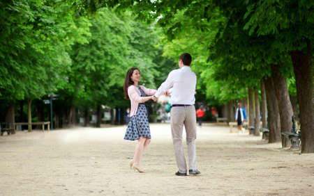 Dating couple n Luxembourg garden of Paris photo