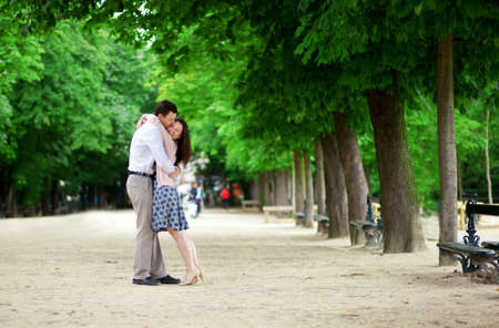 Romantic loving couple n Luxembourg garden of Paris photo