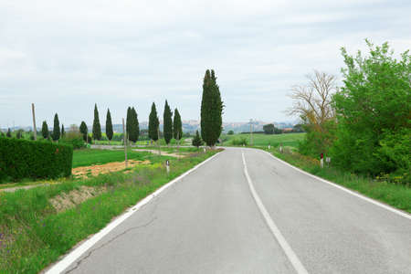 Winging road and cypresses in Tuscany Stock Photo - 14967686
