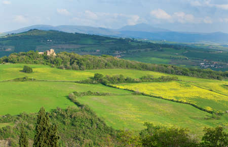Scenic view of Tuscan hills at sunset photo