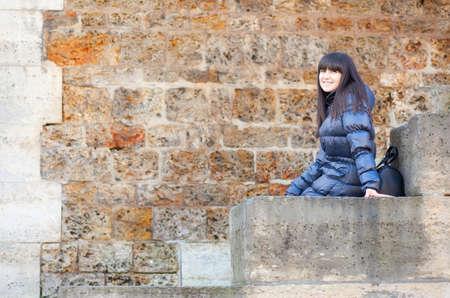 brune: Beautiful brunette girl at Parisian embankment