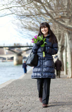 brune: Happy young girl with bunch of fresh tulips at spring