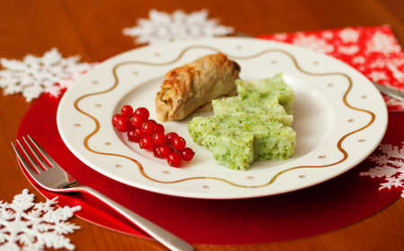 Decorated Christmas dining table with tasty veal and mashed potatoes with broccoli in form of a Christmas tree  photo