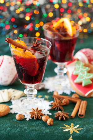 Two glasses of mulled wine, cookies and variation of Christmas spices photo