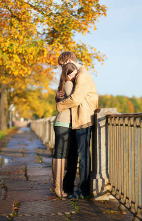 Couple in love tenderly hugging on the Fontanka embankment in Saint-Petersburg, Russia Stock Photo - 15763178