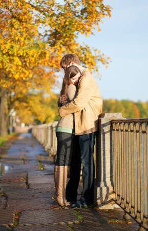 Couple in love tenderly hugging on the Fontanka embankment in Saint-Petersburg, Russia Stock Photo - 15763178