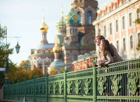 Happy couple near the Church of the Savior on Blood in Saint-Petersburg, Russia