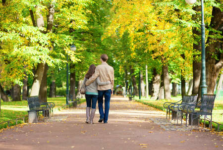 Couple in love walking in park by fall photo
