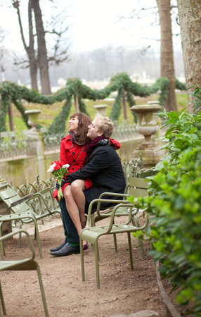 Romantic couple in a park at spring, dating photo