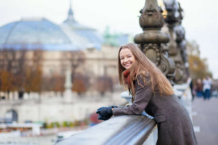 Happy positive girl on the Pont Alexandre III in Paris photo