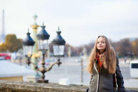 streetlamp: Beautiful young lady in Paris