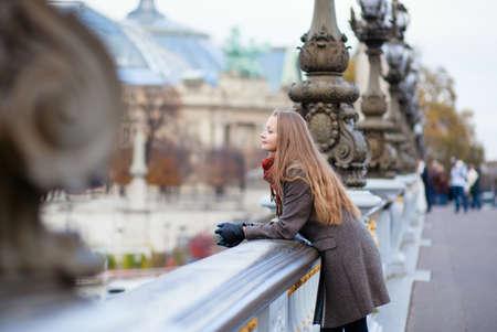 Romantic young woman with beautiful long hair on a bridge in Paris Reklamní fotografie - 16521547