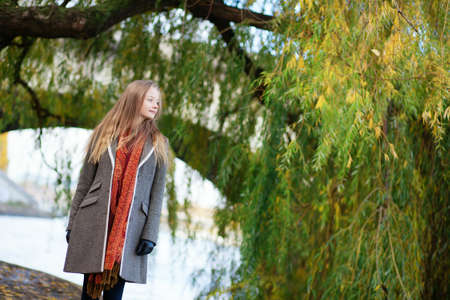Beautiful young woman near a willow tree Stock Photo - 16521546