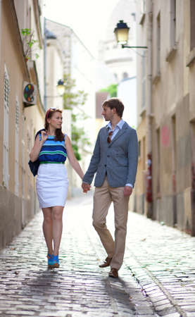 Romantic couple walking on a street of Montmartre in Paris photo