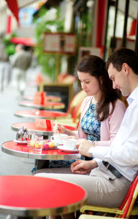 Couple in a Parisian outdoor cafe photo