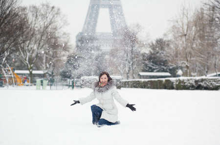 Cheerful young girl enjoying winter day in Paris photo
