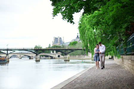 Romantic dating couple is walking by the water