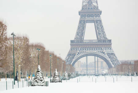 Eiffel tower covered with snow Stock Photo