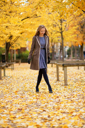 Beautiful young girl walking in park on a fall day Stock Photo - 17501935
