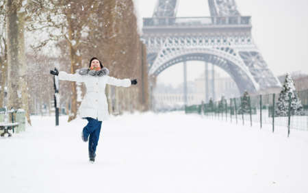Winter in Paris. Happy young girl jumping photo