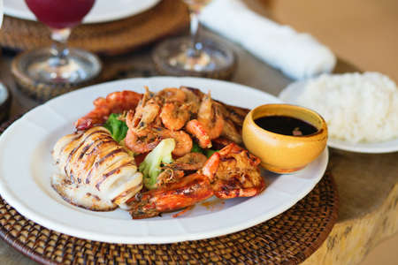 Delicious grilled squid with seafood and vegetables photo