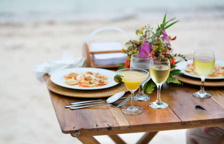 served: Romantic dinner served for two on a beach Stock Photo