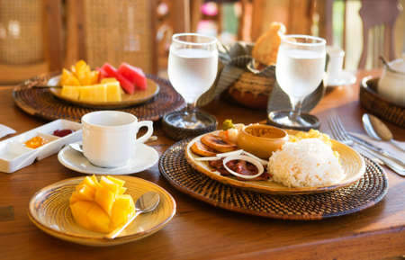 Traditional Philippino breakfast with garlic rice and adobo photo