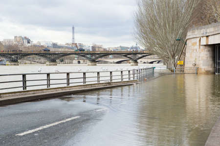 Seine is out of the banks in Paris at winter photo