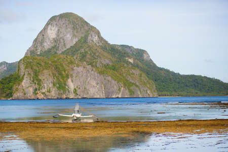 outrigger: Beautiful landscape with an outrigger boat on Palawan