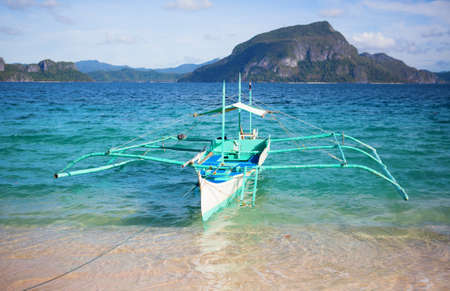 outrigger: Outrigger boat near the shore on Palawan, Philippines