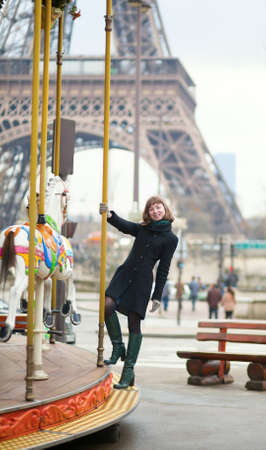 turnabout: Young pretty girl on a Parisian merry-go-round