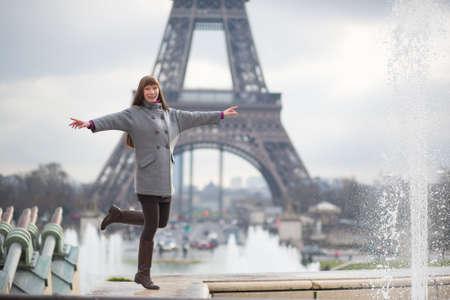 Young beautiful woman in Paris, having fun photo