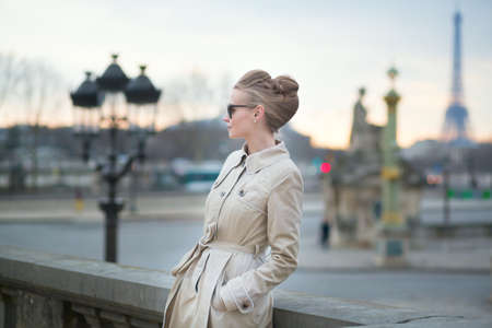 Elegant young Parisian woman outdoors photo