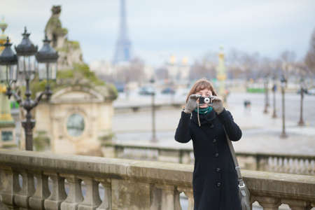 Tourist in Paris taking a picture photo
