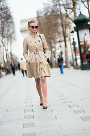 Beautiful young woman on the Champs-Elysees in Paris photo