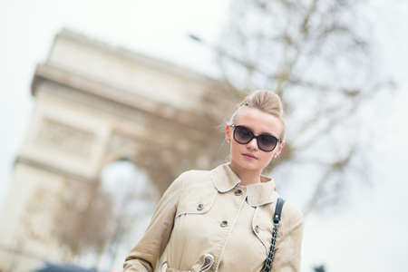 Stylish young woman in Paris photo