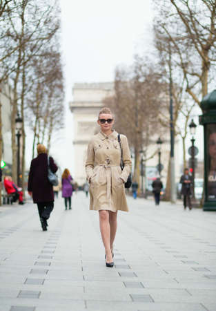 trench: Young trendy Parisian woman in the street