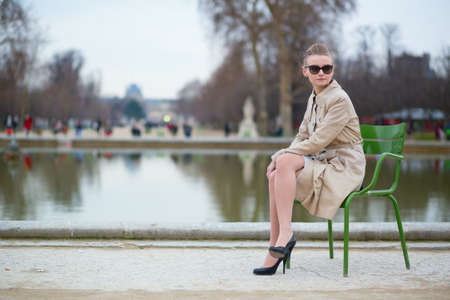 Beautiful woman in the Tuileries park Stock Photo