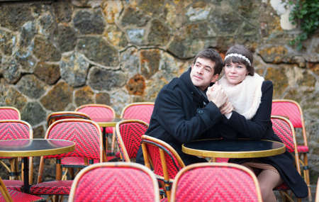 Dating couple in a Parisian outdoor cafe photo