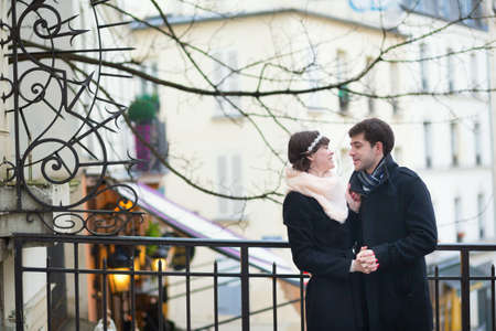 Happy romantic couple having a date on Montmartre photo