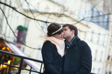 Romantic couple kissing on a Parisian street photo