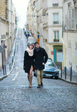 Young couple walking be the streets of Montmartre photo