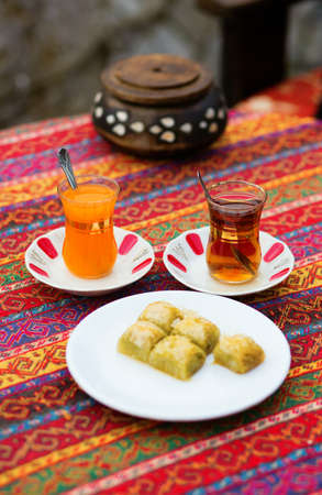 baklawa: Orange and apple Turkish tea served with baklawa