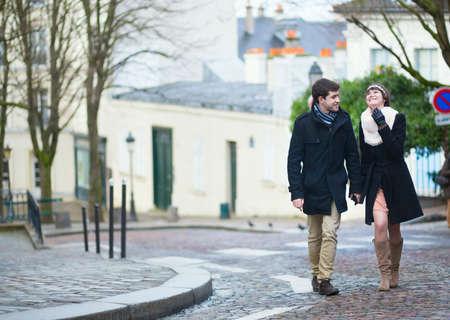 Beautiful young couple walking in Paris photo