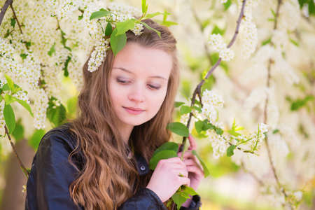 Portrait of a beautiful girl with blooming tree photo