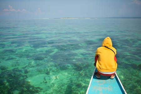 philippino: Philippino man on a nose of bangka boat Stock Photo