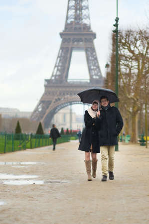 Dating couple under the rain in Paris photo